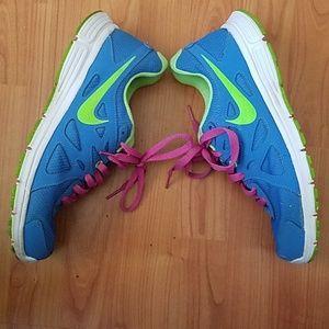 Nike Revolution tennis shoes blue purple green